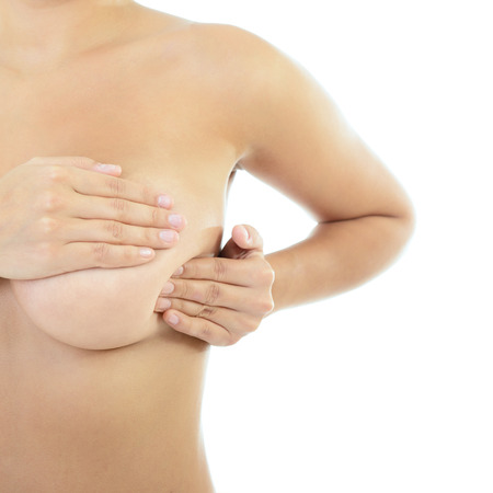 Woman with perfect body examining her breast of mastopathy or cancer, healthcare concept, self palpation over white photo
