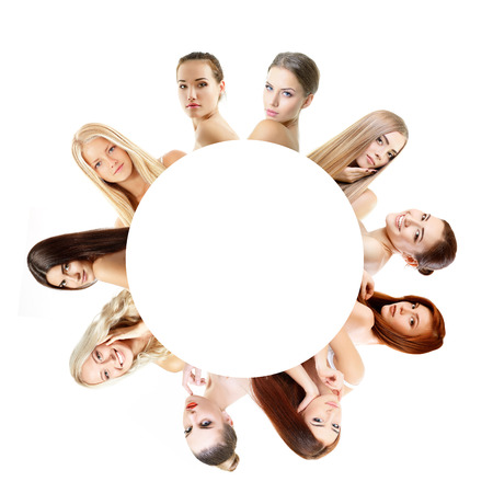 Group of very beautiful girls redheaded, blond and brumette, healthy faces closeup over white with empty round inside Stock Photo - 22674922