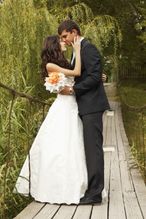 lovely couple: young wedding couple, beautiful bride with goom, summer nature outdoor