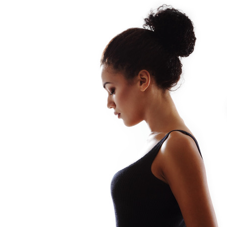 Beauty portrait of young mulatto fresh fashion woman in profile photo