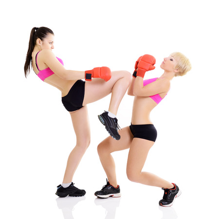 sport training of two boxing young woman, studio over white photo