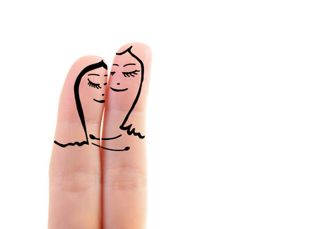 homosexual wedding: two female fingers like a two women embracing in love over white , lesbian concept Stock Photo