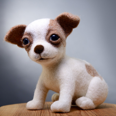 snugly: Toy dog, hand made puppy, felting  Stock Photo