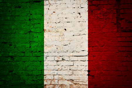 antiqued: Italian flag printed on grunge wall of brick, national italian background Stock Photo