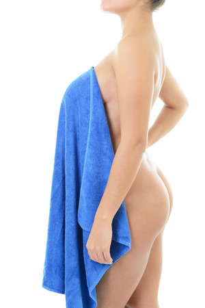 Beautiful young woman with perfect body after bath with towel isolated on white background photo