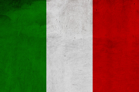 antiqued: Italian flag printed on grunge concrete wall, national italian background