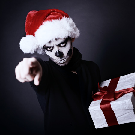 x-mas boy with present and art makeup photo