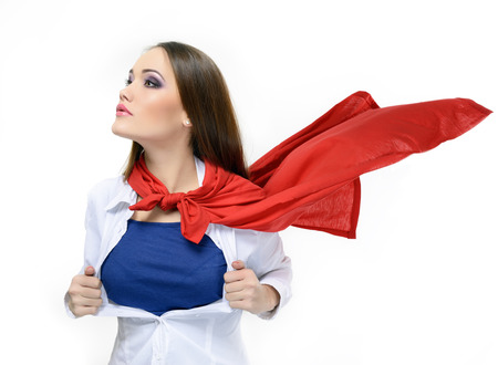 Superwoman. Young pretty woman opening her shirt like a superhero. Super girl over white. Beauty saves the world Stock Photo