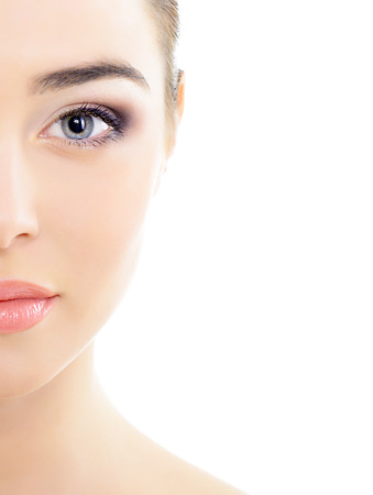 opthalmology: beautiful womans face with accent on eyes, eye scanning technology, health care