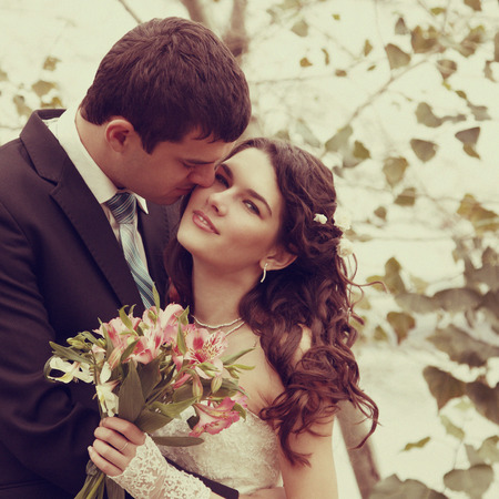 young wedding couple, beautiful bride with groom, autumn nature outdoor, toned and noise added
