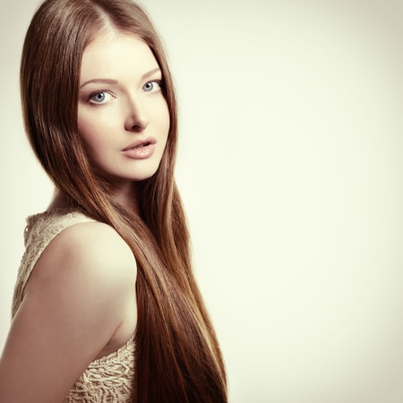 Portrait of attractive young woman over on white background, Beauty female portrait with beautiful healthy face, toned