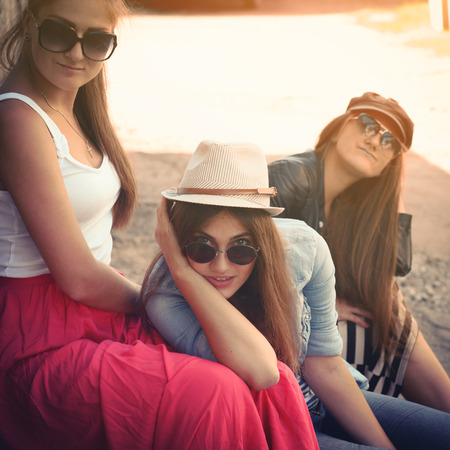 Girls having fun together outdoors, urban lifestyle, image filtered photo