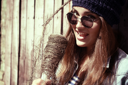 glass fence: beautiful girl with glasses singing outdoor, young singer, toned image Stock Photo