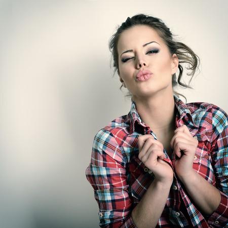 gives: Beautiful teen girl gives kisses. Fashion girl. Toned. Stock Photo