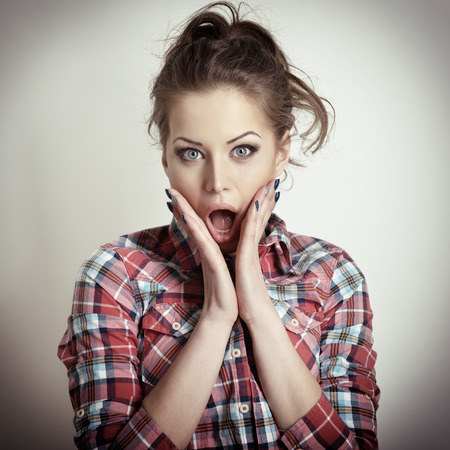 emotional woman: Surprised beautiful girl. Attractive young emotional woman. Toned.
