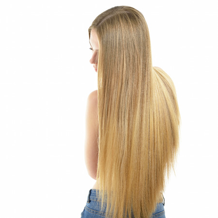 back straight: Hair. Beautiful woman with long healthy shiny smooth hair. Back view of blond girl in jeans over white background. Gorgeous Hair. Hair care. Stock Photo