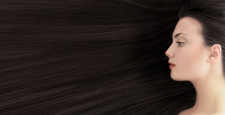 Black hair. Beautiful young woman with  long healthy hair.