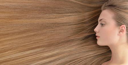 Fair hair. Beautiful young woman with  long healthy hair.