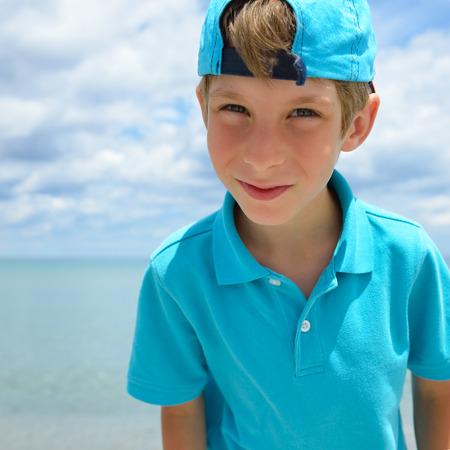 tyrrhenian: Portrait of happy child boy on the beach. Stock Photo
