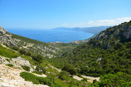 littoral: Picturesque view of sea and mountains, coast of the Tyrrhenian Sea, Sardinia, Italy.