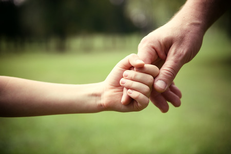 Family, father and child son hands over green summer nature outdoor. Trust and help concept. Toned. Banque d'images