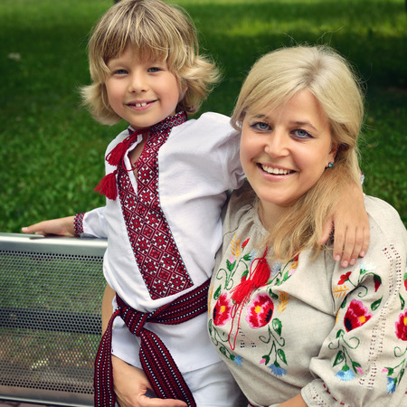blond boy: Portrait of happy ucrainian mother and son in summer park, outdoor, toned Stock Photo