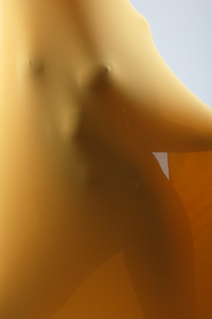 beautiful breasts: Perfect sexy female body in yellow fabric, front view, toned Stock Photo