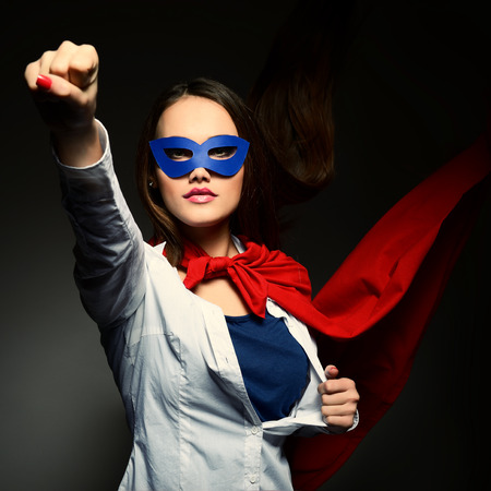 chest women: Young pretty woman opening her shirt like a superhero. Super girl, image toned. Beauty saves the world.