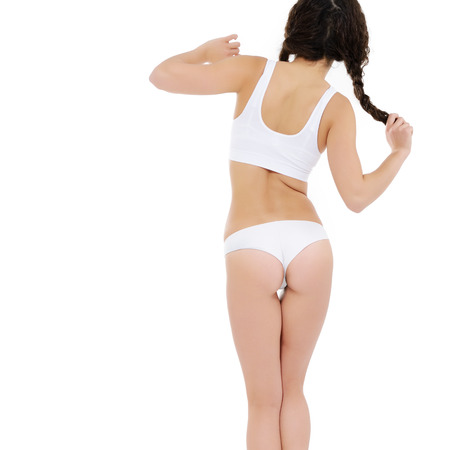 sexy woman panties: Beautiful slim body of woman in lingerie, back view, isolated on white. Stock Photo