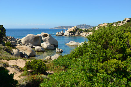 torrid: Beach. Picturesque view of the Mediterranean Sea, Sardinia (west coast), Italy. Travel. Vacation.