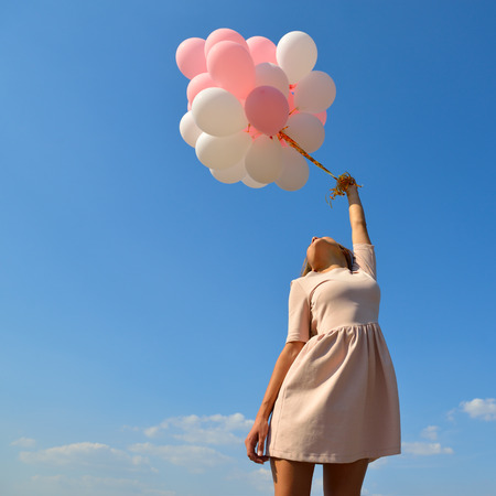 ballons: Fashion girl with  air balloons over blue sky