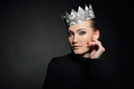 Glamour portrait of beautiful woman model with fresh daily makeup and crown. Fashion female portrait. Stock Photo