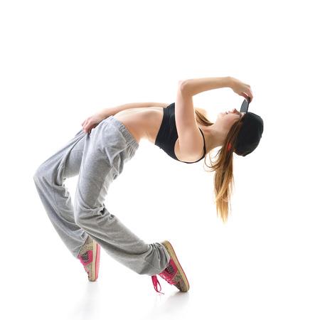 bailarina: Bailarín adolescente de la muchacha de hip-hop sobre fondo blanco Foto de archivo