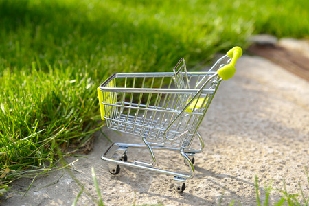 shopping cart: empty mini shopping cart outdoor Stock Photo