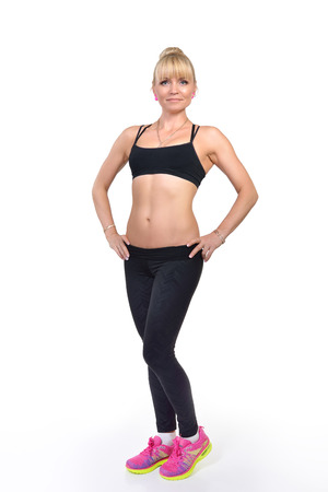 perfect fit: Perfect fit middle-age woman posing in studio