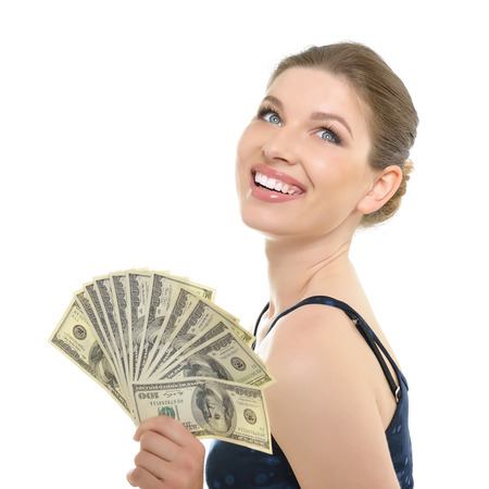 woman holding money: Young beautiful woman holding money and happy smiling