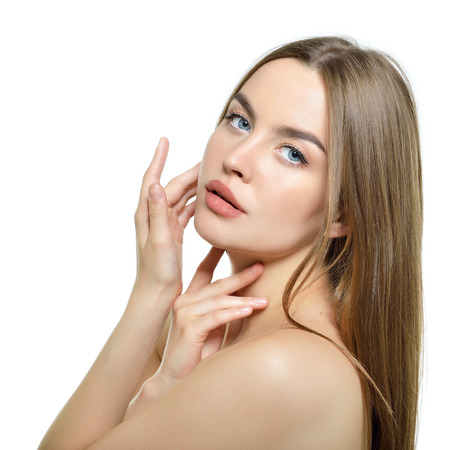face and shoulders: Beauty portrait of young woman with beautiful healthy face and long fair hair over white background