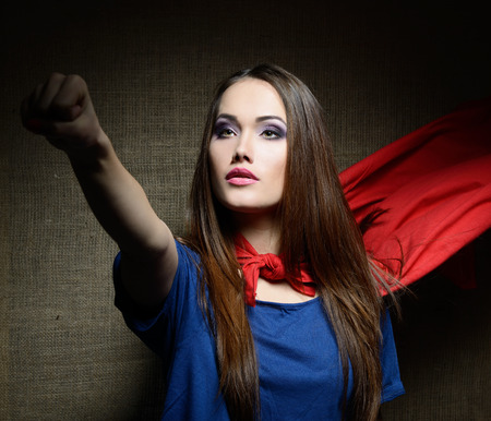 chest women: Young pretty woman in her shirt like a superhero Stock Photo