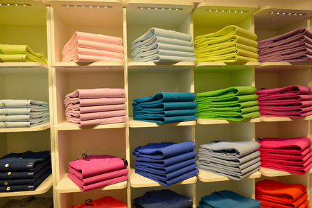 clothes shop: Multicolored pullover clothes in shop