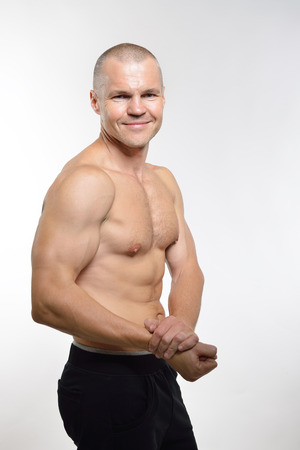 perfect fit: perfect fit man posing in studio Stock Photo