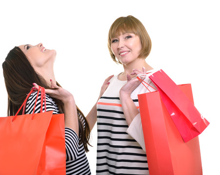 receiving: Happy mother and daughter holding red shopping bags