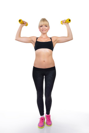 perfect fit: Perfect fit middle-age woman posing in studio with dumb-bells Stock Photo