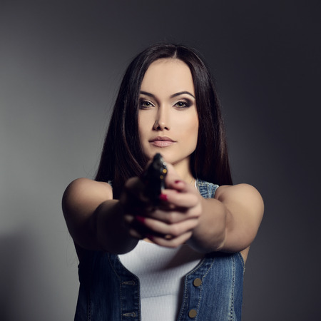 women with guns: Beautiful girl with gun