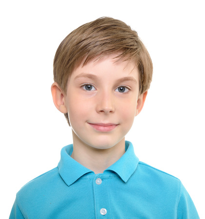 Photo of young happy boy looking at camera.