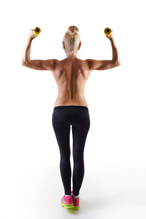 perfect fit: perfect fit woman, back view with dumbells Stock Photo