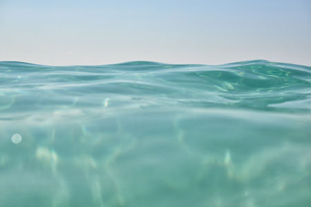 turquoise: Clean turquoise sea wave close up. Natural sea beauty, image toned and noise added.
