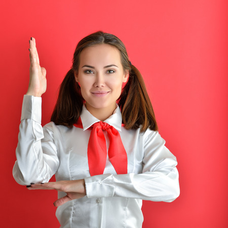 denunciation: Young Pioneer with red scarf and white shirt posing like a pupil in school. Product of the twentieth century. Stock Photo