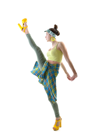 splits: Attractive slim teen girl posing in studio. Full length portrait of young fashion woman. Fitness dancing girl. Steps like splits.