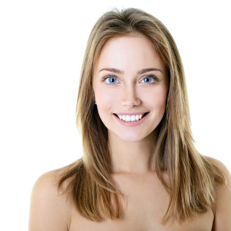 Beauty portrait of girl with beautiful healthy face and long blond hair looking at camera, over white background photo