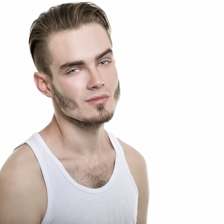 male beauty: Portrait of young man over white background, image toned.